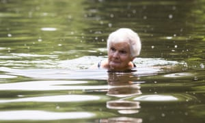 Iris Moore, 85, takes a dip in the pond at Hampstead Heath.