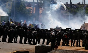 Brazilian law enforcement use tear gas to block a road from demonstrators during a protest ahead of the Confederations Cup soccer match between Brazil and Mexico