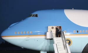 US President Barack Obama and his wife Michelle wave goodbye as they leave from Tegel Airport in Berlin