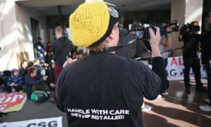 Anti CSG demonstrators block the main entrance to Parliament House in Canberra this afternoon. The Global Mail.