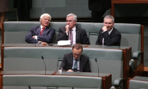 Independents Bob Katter, Andrew Wilkie, Criag Thomson (back row) and Adam Bandt from the Greens during a division in the House of Representatives. The Global Mail.