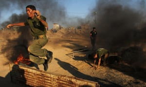 A Palestinian boy takes part in exercises during a military graduation ceremony organized by Hamas movement in Gaza