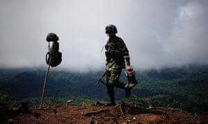 A soldier attends a raid at an illegal coca plantation in Darien, Panama.