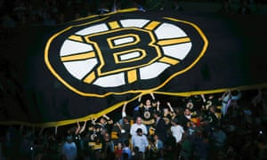 Fans pass a Boston Bruins banner through the stands before game four of the NHL Stanley Cup Finals between the Bruins and the Chicago Blackhawks.