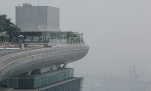 Swimmers look out at the haze as they swim in the rooftop pool at Marina Bay Sands in Singapore. The Pollutant Standards Index (PSI) rose to the highest level on record reaching 371 at 1pm. The haze is created by deliberate slash-and-burn forest fires started by companies in neighbouring Sumatra.