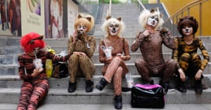 Performers in animal costumes wait to take part in an event to promote a love for dogs in Beijing. Animal rights activists have called for the cancellation of an annual dog meat festival scheduled to take place tomorrow voicing concerns over animal cruelty and food safety, according to China Daily.