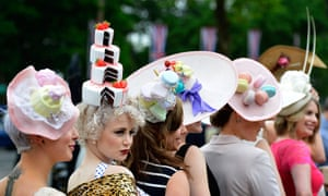 Ladies day at Ascot: Racegoers pose for photographers as they arrive for Ladies Day