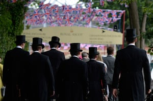 Ladies day at Ascot: Top hats making thier way to the course before racing in Royal Ascot