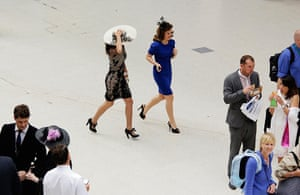 Ladies day at Ascot: Women race across the concourse at Waterloo Station