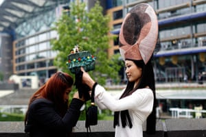 Ladies day at Ascot: Visitors with fancy hats attend the Ladies Day of Royal Ascot