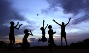 Children play at dusk on the outskirts of the city of Bhubaneswar in India.
