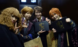 Japanese Harry Potter fans with rather inspired hair styles pose for a picture after they visiting the preview of the Harry Potter exhibition in Tokyo. The exhibition displaying costumes and objects used in the Harry Potter movies will open to the public from June 22.
