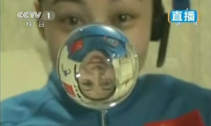 Chinese astronaut Wang Yaping makes a water ball in space