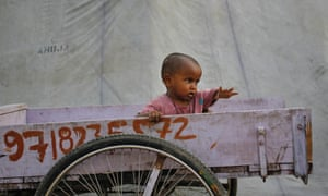 A little child displaced by the rising waters of the river Yamuna sits in a rickshaw by a roadside camp in New Delhi. India's monsoon rains are predicted to ease soon according to weather reports however there has been major flooding following a third straight week of downpour in the north.