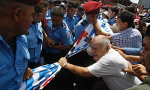 Members of the National Elderly Unit clash with police during the fourth day of protests near the Nicaraguan Social Security building in Managua demanding the government give them a partial pension as they did not qualify for a full pension