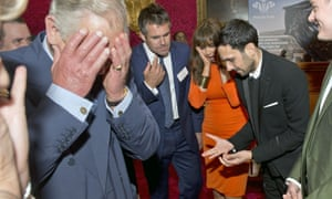 Prince Charles, Prince of Wales reacts as magician Dynamo demonstrates the flexibility of his fingers as Kenny Logan and Carol Voderman look on at a reception for the Prince's Trust Job Ambassadors. Photograph: Pool/Getty Images
