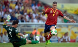 Fernando Torres goes past Mickael Roche to score the second of his four goals in Spain's 10-0 victory over Tahiti