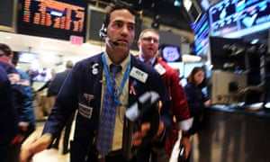 Worried traders work on the floor of the New York Stock Exchange during Wall Street's worst day of the year.