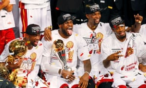 b6079742ac85 Miami Heat s LeBron James (C) holds the Bill Russell MVP Trophy as Dwyane  Wade