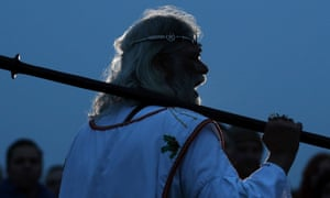 Druid Arthur Uther Pendragon takes part in a dawn ceremony as druids, pagans and revelers wait for the midsummer sun to rise at the the 5,000 year-old stone circle in Stonehenge