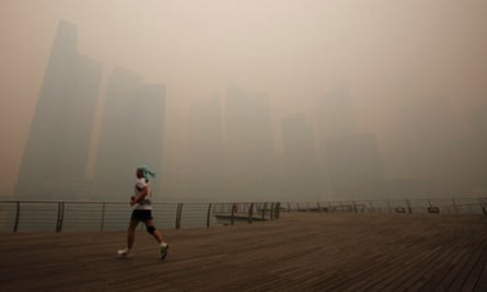 Not the nicest morning for a jog. A man runs along the deserted Marina Promenade as the skyline of Singapore's central business district covered in haze. Haze from fires in Indonesia are blanketing Singapore and could persist for weeks.