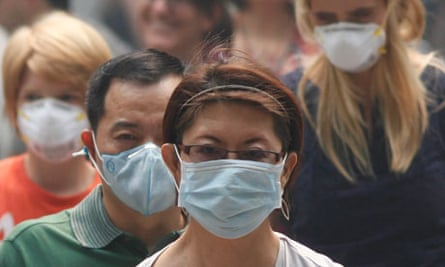 Shoppers in Sinagpore take cover as record levels of haze continues to blanket the country