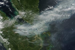 Singapore smog: A satellite view shows smoke from forest fires in Sumatra blown eastwards t