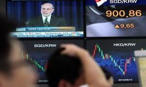 Traders in South Korea take in Bernanke's news.