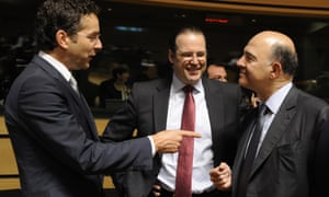 French economy, finance and foreign trade minister, Pierre Moscovici (right) speaks with Dutch finance minister and Eurogroup head Jeroen Dijsselbloem (left) and Swedish finance minister Anders Borg (centre) at today's EU meeting. Photograph:   AFP/Getty Images/John Thys