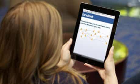 Woman using Facebook on an Ipad