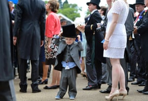 A young racegoer gets into the spirit of the day in his top hat on the fourth day of Royal Ascot.