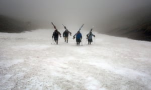 Midsummer's Day skiers from team Tiso set off from Aonach mor on the Nevis Mountain range as thick fog covers the hills of Fort William.