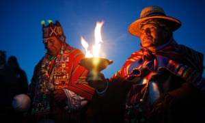 Andean religious leaders performs a traditional new year ritual at the ruins of the ancient civilization of Tiwanaku, Bolivia, at sunrise. Bolivia's Aymara Indians are celebrating the year 5,521 as well as the southern hemisphere's winter solstice, which marks the start of a new agricultural cycle.