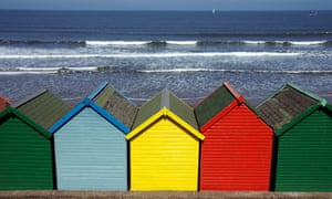 Colorful beach huts by sea