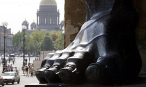 The foot of a sculpture outside the Hermitage museum in St Petersburg where the exhibition is held