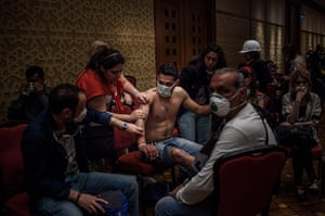 20 Photos: A man treated for the effects of the tear gas in Istanbul