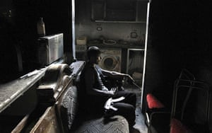 20 Photos: A member of the Free Syrian Army with his weapon inside a house in Aleppo