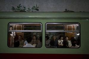 20 Photos: Commuters ride on a subway train at Yonggwang station in Pyongyang