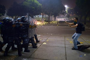 20 Photos: A demonstrator is shot by rubber bullets