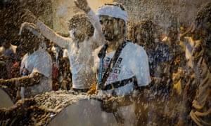Shiite Muslim men celebrate the annual festival of Shaabaniya marking the birth of Imam al-Mahdi in the village of Sanabis, west of Manama, Bahrain.