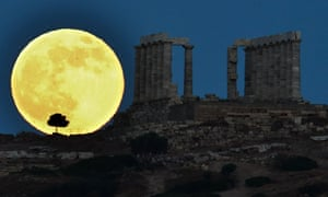 The moon takes a little rest next to the ancient Greek temple of Poseidon at Cape Sounion, Greece.