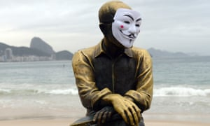 The statue of Brazilian poet Carlos Drummond de Andrade on Copacabana beach is decorated with a Guy Fawkes mask during protests in Brazil.