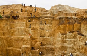 Labourers work at a mine believed to contain gold in Minna, Niger.
