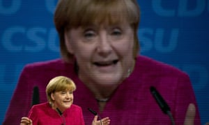 She's behind you. German chancellor Angela Merkel gives a speech during her German Christian Democratic Union CDU party's meeting in Berlin, with 120 top delegates to sign off the programme for the upcoming legislative elections.
