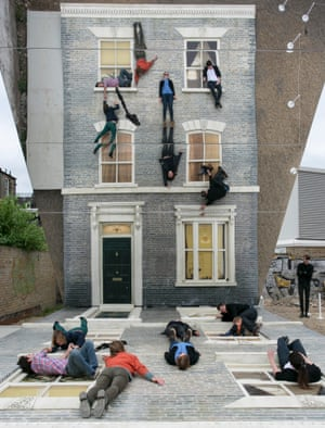 Confused? Visitors enjoy Dalston House by Argentine artist Leandro Erlich in Hackney, London. Erlich has created another of his illusory installations, this time of the facade of a late Victorian terraced house, and with the aid of a mirrored surface it looks as if visitors are scaling the life-size construction.