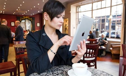 Young woman browsing the Internet on an iPad