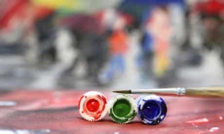 Three coloured tubes of acrylic paint