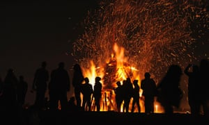 People attend a party held during the night of the San Juan bonfire on the beach of Playa de Poniente in Gijon, Spain. Fires formed by burning unwanted furniture, old school books, wood and effigies of malign spirits are seen across Spain as people celebrate the night of San Juan, a purification ceremony coinciding with the summer solstice.