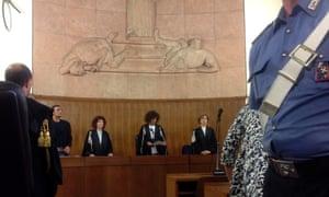 President of the court Giulia Turri (C) reads the sentence for former Italian prime minister Silvio Berlusconi in Milan June 24, 2013.