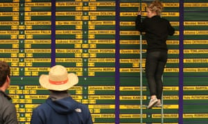 The Wimbledon scoreboard is updated during day one of the Wimbledon championships, England.